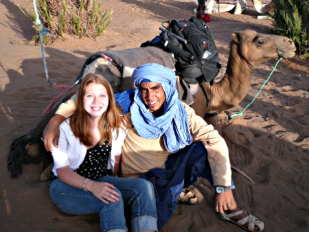 Sarah with her Berber guide on a camel trek through the Moroccan Sahara